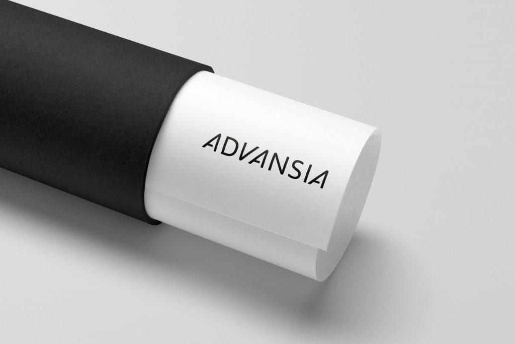 Grafisk profil for Advansia presentert på rull med arkitekttegning