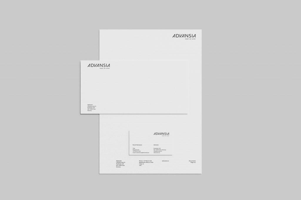 Grafisk profil for Advansia presentert på brevark, konvolutt og visittkort