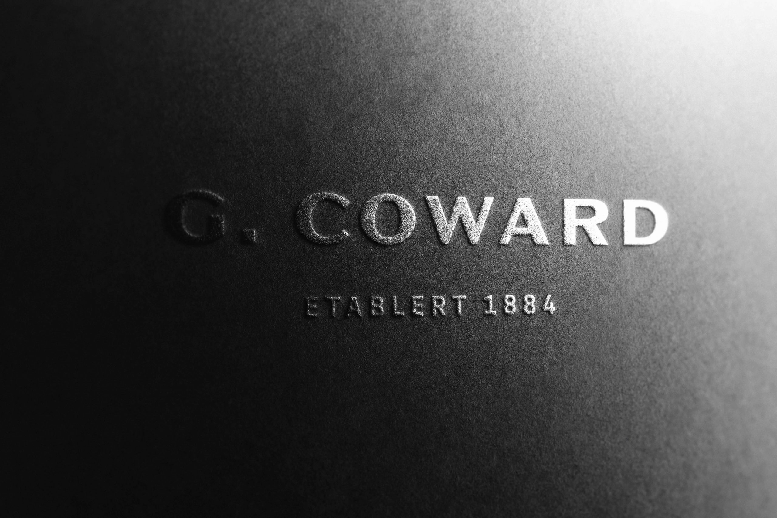 Logo av G. Coward preget ut på papir